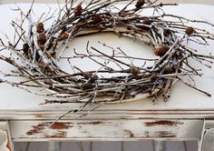 branch wreath tutorial - she ends up spray painting it white, but I like unpainted sticks better
