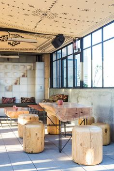 love the play of the design on the ceiling, loads of natural light and air, combinations of textures and the natural elements used in unexpected ways. Ace Hotel Rooftop Lounge/Remodelista