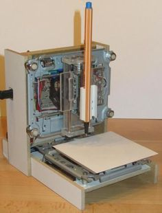 Micro CNC Ploter made of CD/DVD drives. Uses A4988 drivers powered by DC/DC converter an 8 AA batteries.