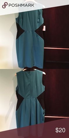 Calvin Klein Business Dress Calvin Klein, originally purchased from TJ Maxx. Size 12, teal with slimming black detail. Never worn, tags attached. Dress has loops for accent belt, which is pictured separately. Calvin Klein Dresses Midi