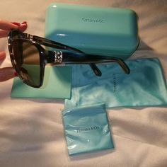 BNWOT.. Tiffany Navy Blue w/Crystals Sunglasses BNWOT.. Tiffany Navy Blue w/Crystals Sunglasses. These are the most beautiful sunglasses and I am torn over keeping them or not! Absolutely Gorgeous!  There are no scratches, markings or imperfections at all!  They come with a cloth case, cleaning cloth, paperwork & the hard case. If traded it will only be considered for something that I just HAVE to HAVE! lol. Tiffany & Co. Accessories Sunglasses