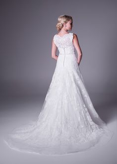 Oleg Cassini A-line wedding gown with allover lace and beaded belt detail.