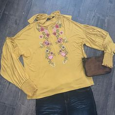 Mustard floral embroidered blouse! $32.99  • • • Small clutch coming soon www.shannasthreads.com