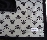 These black skulls on a silver background is a great look for the season.   Supersoft Minky fabric will cuddle precious pups.  Use the handmade, designer  blanket in a carrier, on top of a bed, or protect a sofa from pet hairs.     Highest quality craftsmanship and materials. The blankets are thick, cuddly and silky-soft. Made in Oregon.