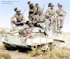 Italian Major Benvenuto Fracassi and his men of the 7° Reggimento Bersaglieri on a disabled British Vickers Mk. VIB light tank, Tobruk front, Lybia 1941.