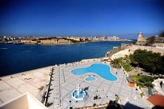 The Outdoor Pool surrounded by the sixteenth century fortifications of Malta's capital city Valletta and breathtaking sea views of Marsamxett Harbour and Manoel Island. #Hotel #Malta #travel #sea #Holidays