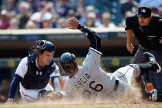 Garcia safe at home:    Avisail Garcia #26 of the Chicago White Sox slides safely into home plate as John Ryan Murphy #12 of the Minnesota Twins applies the tag during the seventh inning of the game on April 14, at Target Field in Minneapolis, Minnesota. The White Sox defeated the Twins 3-1.    -        © Hannah Foslien/Getty Images