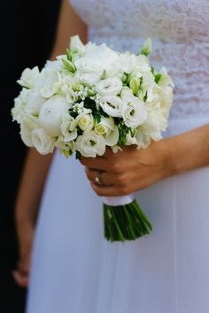 Classic wedding bouquet - ivory bouquet of ranunculus, peonies, spray roses and stephanotis {Elias Kordelakos Photography}