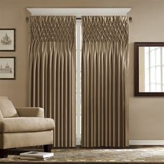 """Give any room an updated look with the Madison Park Caitlyn window panel. This faux silk panel features pintucking details that create a diamond lattice pattern on the top. This energy saving panel is lined and feature interlining with fleece material to retain the heat or keep cool air from escaping your room. The panel also has a 3"""" rod pocket detail. The panel comes in 84"""" and 95"""" lengths and in the colors of white, cream, tan, brown, blue and pink."""