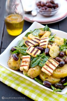 Photo about Greek potato salad with spinach, olives and griled halloumi. Image of grilled, spinach, halloumi - 48822313 Greek Potato Salads, Grilled Halloumi, Romanian Food, Spinach Salad, Greek Recipes, Tzatziki, Potato Recipes, Prosciutto, Pasta Salad