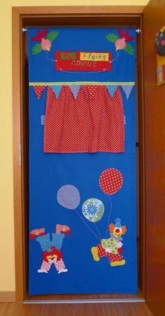 doorway puppet theater - like the flag banner
