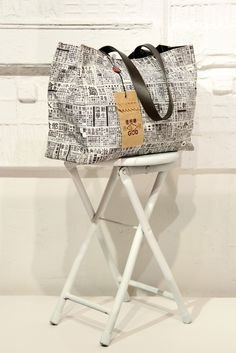 This black and white large tote bag from Goods of Desire is not really made out of newspaper. But this unique bag does feature a newsprint pattern that is taken from actual Chinese newspapers.