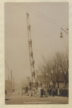 Vancouver fire department showing off their aerial ladder, 1910