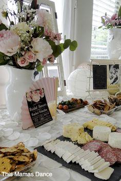food table, blush gold and cream bridal shower, floral arrangements