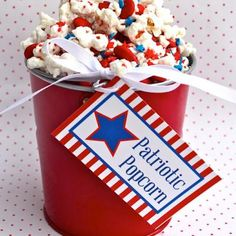 Patriotic Popcorn with free printable.  You could make big batches of this to set out at your next BBQ, or make mini buckets to hand out as party favors at your Memorial Day or 4th of July shindig.
