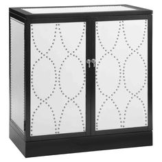 Adorned with white facings and nailhead accents, this chic cabinet adds sleek dimension to your home, while 2 doors offer interior storage for books and seas...649
