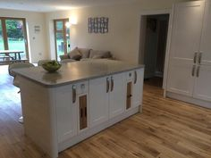 Modern kitchen gloss cream grey worktop Corian Howdens range master country oak floor island