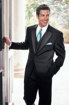 Groomsmen suits with Tiffany blue accents! Maybe not black, a dark tan for a backyard wedding?