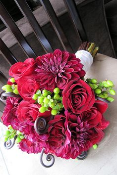 Flowers, some how incorporate grapes, wine into them? and for centerpieces? Wine bottle?