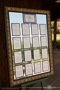 Elegant seating chart idea.  Layered table assignments attached to a mirror.  www.weddinginvitationsbystaccato.com