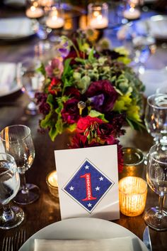 Wedding table number inspired by sailor tattoos {Photo by Viera Photographics via Project Wedding}