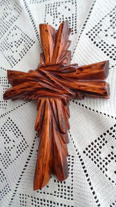 Unique, Hand Carved, Rustic, and Elegant Fir Wood Wall or Table Cross. Wall Art designed by Ches Gonzales. Dimensions are as follows: 7.5L by 5arm length, width is 1 and 1/2 . This particular cross has a light to medium colored stain and a tung oil finish . All of our crosses