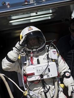 Pilot Felix Baumgartner of Austria salutes during the third manned flight of the Red Bull Stratos mission in Roswell, New Mexico, USA on October 9, 2012. Image courtesy of Red Bull
