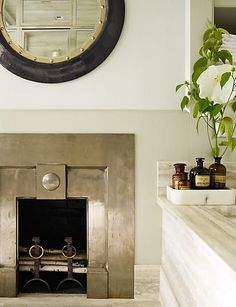 Steven Gambrel added this amazing deco fireplace surround in a bathroom. Oh, the extravagance! It is so unexpected and so perfect with that marble. Metal Fireplace, Home Fireplace, Fireplace Surrounds, Fireplace Design, Fireplace Mantels, Fireplaces, Mantles, Fireplace Mirror, Bathroom Fireplace