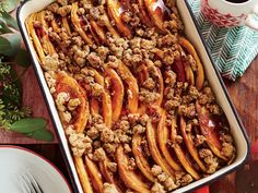 Pancake Bake with Cinnamon Streusel Recipe | Don't even think about spending Christmas morning flipping pancakes. Instead, turn them into a bread pudding-like casserole. Prepare the recipe at least eight hours ahead so the pancakes absorb the egg-and cream-mixture. There's no easier way to serve brunch to a crowd than with a breakfast casserole, but they're usually savory and egg-based. This pancake bake is for the brunch-goers with a sweet tooth, and there won't be a streusel crumb left.