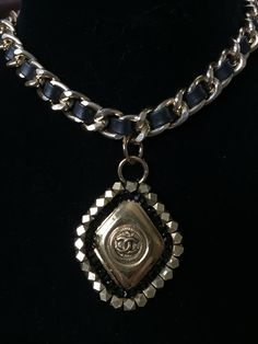 This classic choker started with an authentic Chanel earring that I beaded and suspended from leather chain.