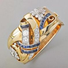 RETRO DIAMOND AND SAPPHIRE HINGED BRACELET. Lavish and sculptural 14k pinkish-yellow gold with ribbons of French cut sapphire and bead or bezel set diamonds in platinum. Two OEC diamonds, approx. 1.03 cts. and 1.20 cts., two OEC diamonds 1 cts. TW, approx. 6.20 cts. diamonds throughout, ca. 1940.