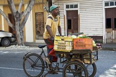 Explore Dominican Republic holidays and discover the best time and places to visit. Street Vendor, Colonial Architecture, Dominican Republic, Haiti, Lonely Planet, Caribbean, Cargo Bike, Bicycles, Novels