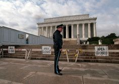 """In this Wednesday, Nov. 15, 1995, file photo, U.S. Park Service Police Officer P.G. Carroll stands in front of closed signs at the Lincoln Memorial in Washington, during a partial shutdown of the federal government. There have been 17 government shutdowns since 1976, ranging in length from one to 21 days. (AP Photo/Charles Tasnadi, File)"" AP483498288716_8.jpg"