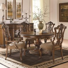 This five piece set is a great piece for a formal dining room that may not have enough room for a long rectangular table. The round single pedestal table can comfortably seat four in its side and arm chairs. The 18 inch leaf changes the table top shape from a circle to oval shape allowing you to seat two more people. The single pedestal base is full of carved detail and leaf patterns while the top shows off veneer patterns and inlaid designs. Intricate pierced back design of the arm and…