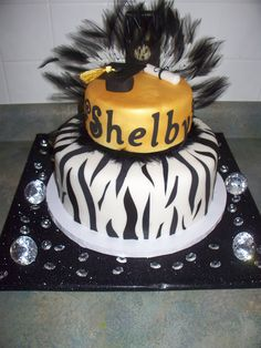 Shelby's Graduation Cake - Key Lime Cake with Key Lime Buttercream layered with Rasberry.  Made for my nieces graduation from high school...High School colors were Black and Gold but wanted to make it funky for her with the feathers, zebra stripes and diamonds