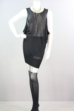 Totally essential black knit tunic top or dress featuring a deep scoop neckline and oversized armholes. Slouchy fit. Be daring and wear it with a black bra or layer it with a cami for a more conservative look! 85% Viscose/15% Nylon. One Size Fits Most. $31.99