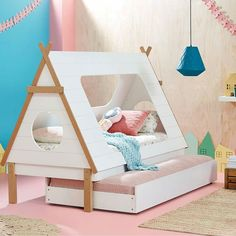 How gorgeous is this little cubbyhouse bed from @domayne_australia? I particularly love that it has a trundle bed underneath. Some of my fave memories from childhood are of friends sleeping over for slumber parties #milktoothaustralia #nurserydecor #nursery #childrensroom #childrensinteriors #kidsdecor #kidsbedroom #cubbyhousebed #trundlebed #pinkandblue #colourfulkidsroom #colourful #kidsroom #childrensbedroom #childrensbed #kidsbed #housebed #girlsroom #hustlinginstamum #newcastleau…