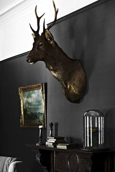 Black walls, glass, gold and taxidermy #interior #design #black #decor