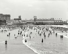 "Atlantic City circa 1911. ""Bathing at the Steeplechase."" George C. Tilyou's Steeplechase Pier and some interesting signage, including a bear-filled Steiff Toys billboard."