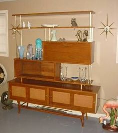 Teak and brass display unit room divider.