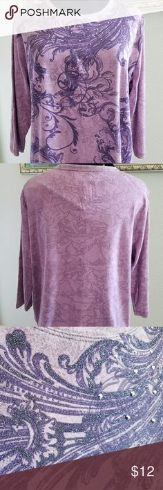 🎨 Nicole Miller embellished t-shirt Size 2X This is a great top by Nicole Miller. Pretty purple and lavender scrolls embellished with subtle glitter accents and metallic studs across the front. 3/4 length sleeves and a crew neckline make this a good t for all seasons.   Smoke free home but we do have pets. Nicole Miller Tops Tees - Long Sleeve