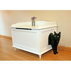 This litter box enclosure is a total game changer.  Inside it has a partition with another entrance to the actual litter box