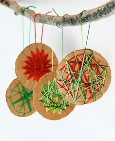 Kids will enjoy making these quirky Christmas decorations (and you just might too!). Simply cut out cardboard circles, snip around the edges then weave wool around the disc to create patterns.  Voi...