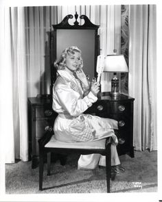 Doris Day.  That's a sad little vanity, nothing, no perfume bottles, no powder boxes, no combs ... nothing.  :(