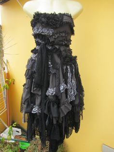 vintage inspired gothic boho dress with black and grey lace ruffles,shabby strips and big black roses.... $145.00, via Etsy.