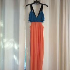 Color block maxi dress with side cutouts Peach, blue, and black maxi dress with side cutouts. Purchased this at a boutique, only wore it once Boutique Dresses Maxi