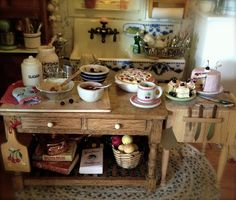 Kathleen Holmes dollhouse kitchen. Cherry cake made by 2smartminiatures.