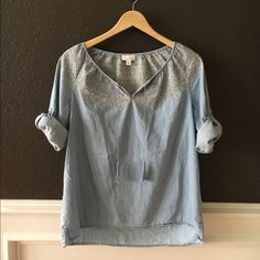 Darling chambray top Easygoing summer style chambray shirt. Pale blue with taupe embroidery around the neckline and rope accent with tassels. Sleeves can be worn rolled up or down, and would be darling with a pair of white jeans all summer long. Fiesta inspired. Excellent condition. J. Jill Tops
