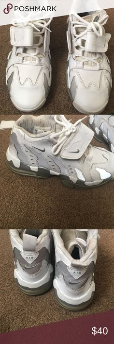Nike sneakers White and silver ( reflective) Nike sneaks good condition normal wear No tears grade school size 6 Y boys Nike Shoes Sneakers