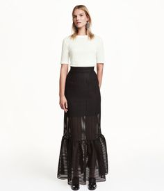 Long, fitted skirt in textured-stripe mesh with a wide ruffle at hem and visible back zip. Short jersey liner skirt.